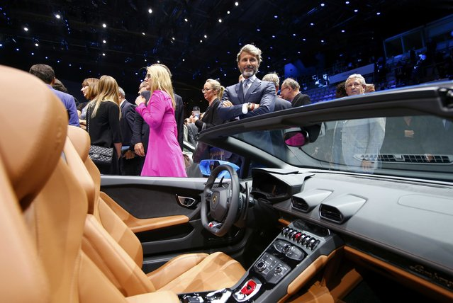 Lamborghini CEO Stephan Winkelmann stands next to the Lamborghini Huracan LP 610-4 Spyder during the Volkswagen group night ahead of the Frankfurt Motor Show (IAA) in Frankfurt, Germany, September 14, 2015. (Photo by Kai Pfaffenbach/Reuters)