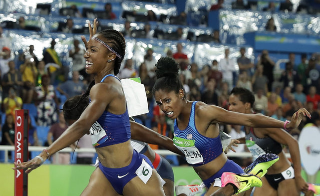 Brianna Rollins from the United States celebrates after winning the gold medal in the women's 100-meter hurdles final during the athletics competitions of the 2016 Summer Olympics at the Olympic stadium in Rio de Janeiro, Brazil, Wednesday, August 17, 2016. (Photo by Matt Slocum/AP Photo)