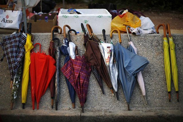 Umbrellas are seen in an area blocked by pro-democracy protesters near the government headquarters in Hong Kong October 1, 2014. (Photo by Carlos Barria/Reuters)