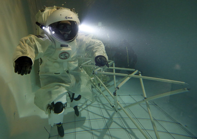 National Diving School director Jerome Vincent, wearing a Gandolfi space suit, trains in a swimming pool in Marseille October 22, 2014. (Photo by Jean-Paul Pelissier/Reuters)