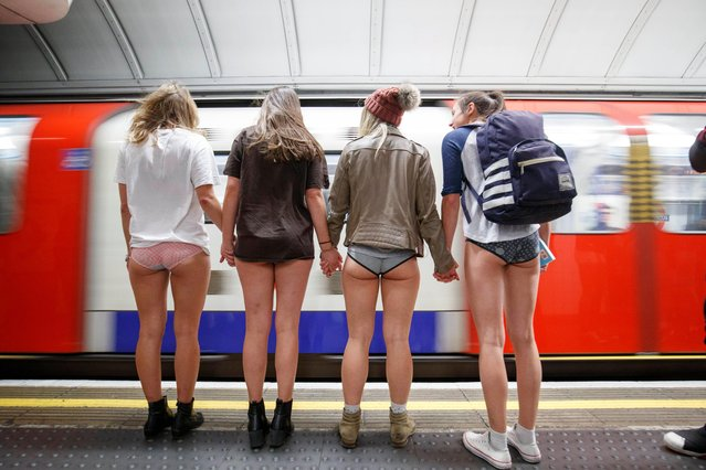 Passengers wear no trousers as they ride the London Underground in London, Britain, 07 January 2018. The No Pants Subway Ride is an global annual event where people take the public transport while they are not wearing trousers to surprise other passengers. This event takes place on the first Sunday of every year in the world's major cities. (Photo by Tolga Akmen/EPA/EFE)