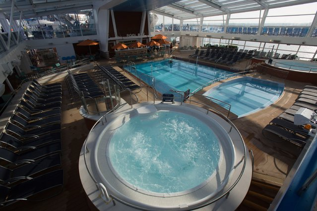 Swimming pools onboard the cruise ship Quantum of the Seas which is currently docked at Southampton on October 31, 2014 in Southampton, England. (Photo by Matt Cardy/Getty Images)