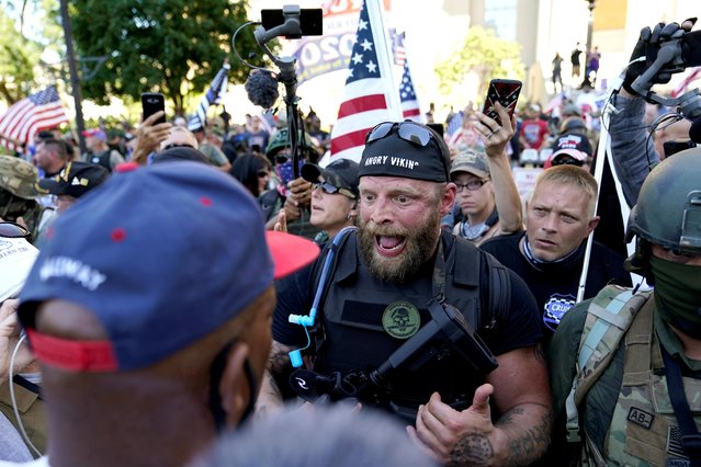 Far-right activists and self-described militia members confront Black Lives Matter activists on the day of the Kentucky Derby horse race in Louisville, Kentucky, U.S. September 5, 2020. (Photo by Bryan Woolston/Reuters)