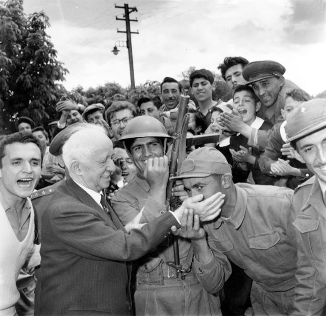In this May 31, 1960 file photo, a Turkish soldier kisses the hand of Ismet Inonu, the 75-year-old former Turkish president and leader of the Republican People's Party, as the soldiers maintain guard duty outside his home in Ankara, Turkey. The attempted coup  unfolding in Turkey is surprising to many observers who had thought the days of military intervention in politics were over. The military staged three coups between 1960 and 1980 and pressured a premier out of power in 1997. In 2007, the military threatened to intervene in a presidential election and warned the government to curb Islamic influences, but the action backfired and the civilian government exerted more influence over the armed forces after that. (Photo by Jim Pringle/AP Photo)
