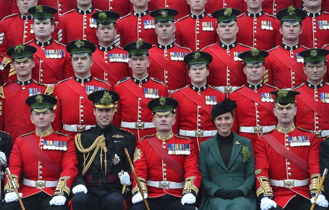 Britain's Catherine, Duchess of Cambridge (2nd R) and her husband Prince William (2nd L) pose for an official photograph as they attend a St Patrick's Day Parade at Mons Barracks in Aldershot, southern England March 17, 2013. Prince William attended the Parade as Colonel of the Regiment, and the Duchess presented the traditional sprigs of shamrocks to the Officers and Guardsmen of the Regiment. (Photo by Toby Melville/Reuters)