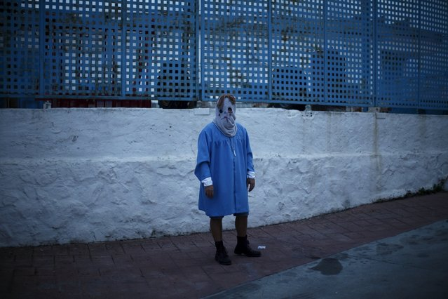"""A man dressed as the character of Tomas from the movie """"The Orphanage"""" takes part in the second edition of """"Noche del Terror"""" (Horror night) during Halloween celebrations in the neighborhood of Churriana, near Malaga, southern Spain, October 31, 2015. (Photo by Jon Nazca/Reuters)"""
