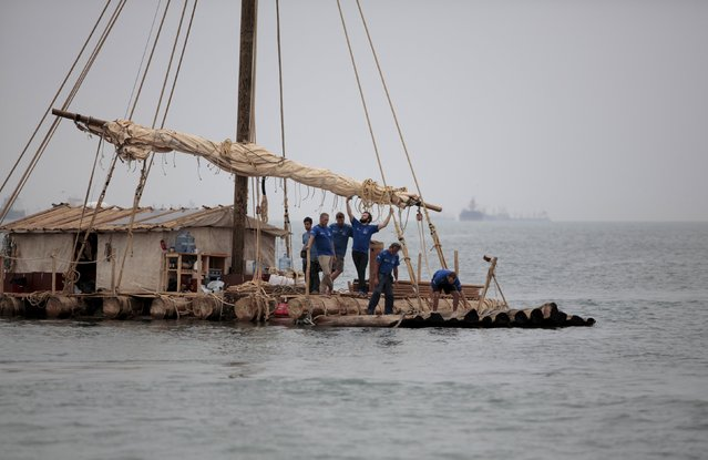 One of two wooden rafts of the Kon-Tiki2 expedition depart from Peru's Callao Naval Shipyard in Peru, November 7, 2015. (Photo by Guadalupe Pardo/Reuters)