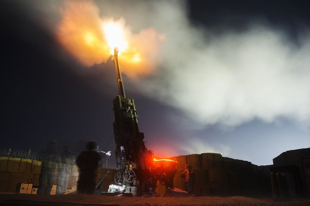 U.S. soldiers from the 3rd Cavalry Regiment take part in an artillery exercise on forward operating base Gamberi in the Laghman province of Afghanistan December 24, 2014. (Photo by Lucas Jackson/Reuters)