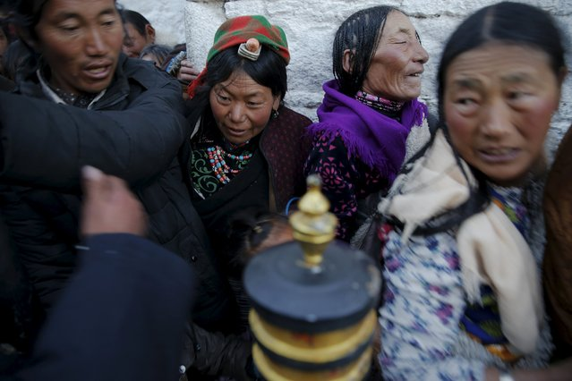 Pilgrims struggle at narrow entrance as they wait to enter the Jokhang Temple in central Lhasa, Tibet Autonomous Region, China early November 20, 2015. (Photo by Damir Sagolj/Reuters)