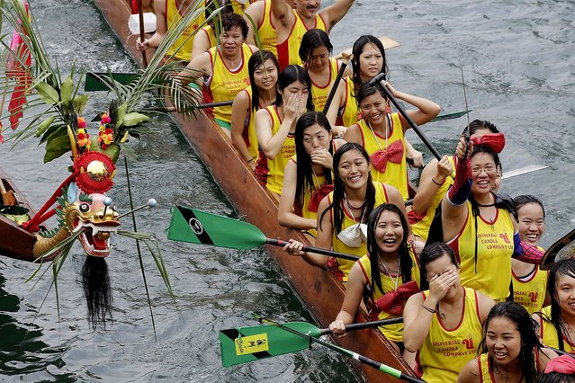 Competitors line up their boats for some formalities during the Aberdeen Dragon Boat Races. (Photo by Jessica Hromas/Getty Images)