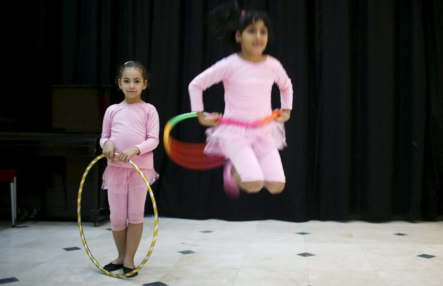 Palestinian girls take part in a ballet dancing course, run by the Al-Qattan Center for Children, in Gaza City November 25, 2015. (Photo by Suhaib Salem/Reuters)