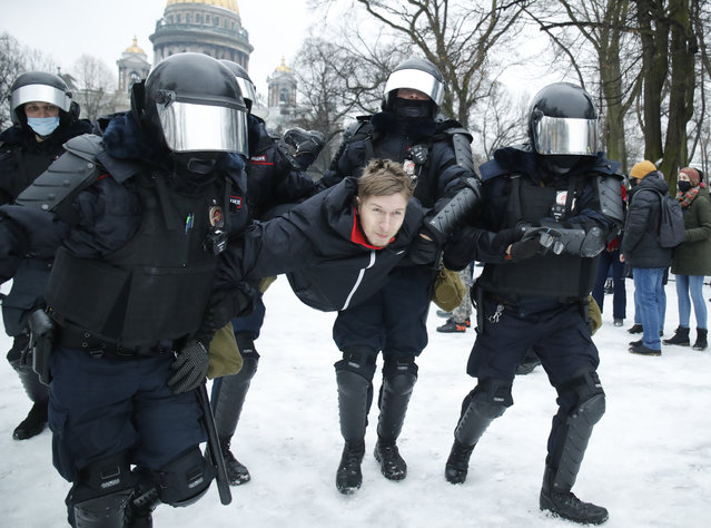 Police detain a man during a protest against the jailing of opposition leader Alexei Navalny in People gather in St.Petersburg, Russia, Saturday, January 23, 2021. (Photo by Dmitri Lovetsky/AP Photo)