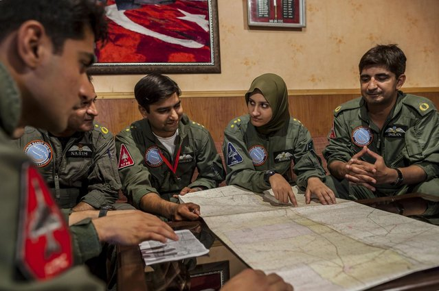 Ayesha Farooq, 26, (2nd R) Pakistan's only female war-ready fighter pilot, attends a briefing with colleagues at Mushaf base in Sargodha, north Pakistan June 6, 2013. (Photo by Zohra Bensemra/Reuters)