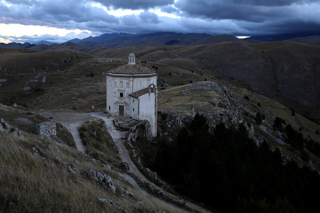 A church stands isolated from other buildings in the small town of Rocca Calascio, close to Santo Stefano di Sessanio in the province of L'Aquila in Abruzzo, inside the national park of the Gran Sasso e Monti della Laga, Italy, September 6, 2016. (Photo by Siegfried Modola/Reuters)