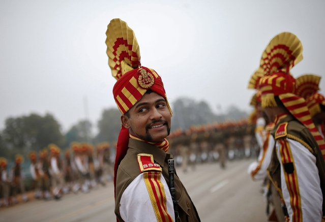Indian soldiers take part in the rehearsal for the Republic Day parade on a winter morning in New Delhi January 21, 2015. (Photo by Ahmad Masood/Reuters)