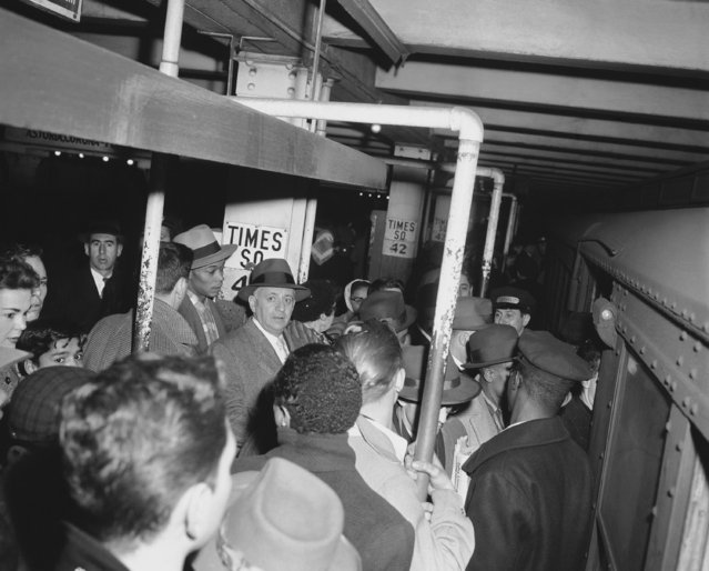 Crowd at Times Square station subway in New York City on March 6, 1956. (Photo by AP Photo/HVN)
