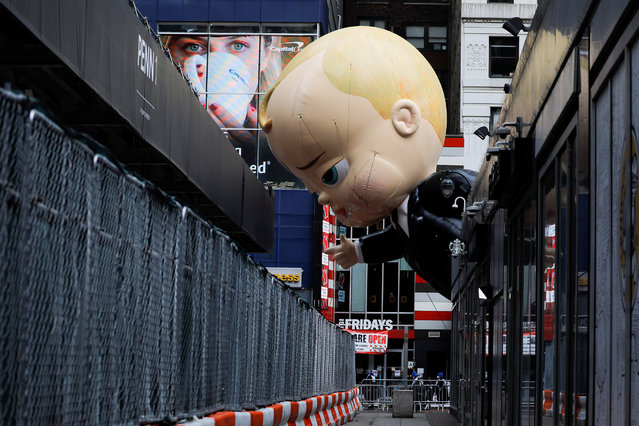 "The ""The Boss Baby"" balloon is seen during the 94th Macy's Thanksgiving Day Parade closed to the spectators due to the spread of the coronavirus disease (COVID-19), in Manhattan, New York City, U.S., November 26, 2020. (Photo by Andrew Kelly/Reuters)"
