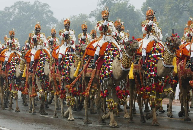 An armed Indian military regiment riding camels march in India's Republic Day parade in New Delhi January 26, 2015. (Photo by Jim Bourg/Reuters)