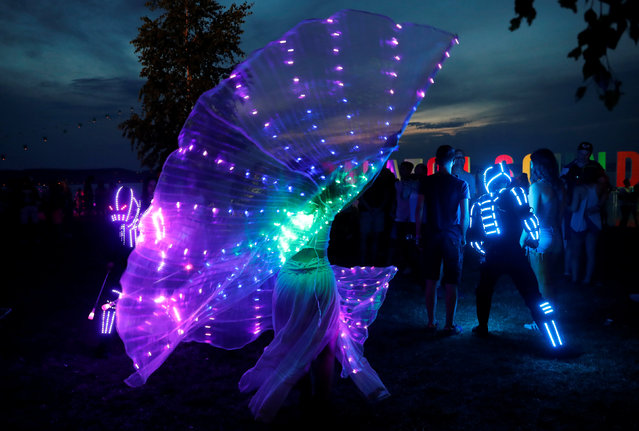 An artist dances during the Balaton Sound music festival in Zamardi, Hungary, July 5, 2018. (Photo by Bernadett Szabo/Reuters)
