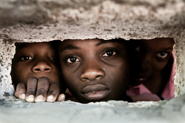"""Behind the Wall"". Pupils from the school of Degerme behind the wall of the school. Location: Abricots, Grand'Anse department of Haiti. (Photo and caption by Christophe Stramba-Badiali/National Geographic Traveler Photo Contest)"