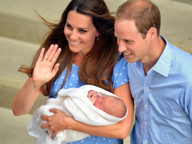 Safe in the hands of the Duchess of Cambridge, the Royal couple and their son who was born Monday, leave the Lindo Wing of St Mary's Hospital in west London Tuesday July 23, 2013. (Photo by John Stillwell/AP Photo)