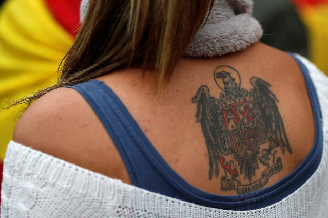 A supporter of Spain's late dictator Francisco Franco showing her tattoo during a gathering commemorating the 41st anniversary of Franco's death at Madrid's Plaza de Oriente, Spain, November 20, 2016. (Photo by Javier Barbancho/Reuters)