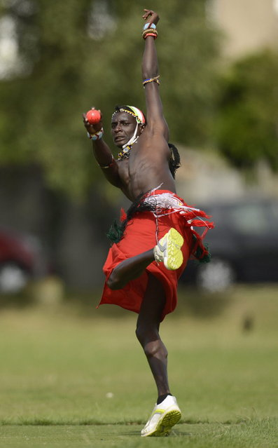 "Sonyanga Ole Ngais of the Maasai cricket warrior team from Kenya bowls during a cricket match against English team ""The Shed"" during the Last Man Stands cricket tournament at Dulwich sports ground in south London September 1, 2013. (Photo by Philip Brown/Reuters)"