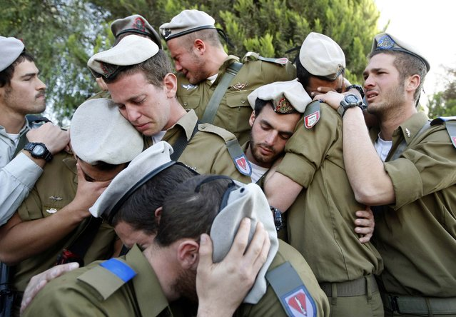 Israeli soldiers mourn during the funeral of their comrade Alex Mashavisky at a cemetery in Beersheba in this January 7, 2009 file photo. Eric Gaillard: I was in Israel to help out the Reuters Jerusalem office during the Israeli offensive in the Gaza Strip in January 2009. They asked to go to Beersheba to cover the funeral of an Israeli soldier, Alex Mashavisky, who was killed in an operation in Gaza. (Photo by Eric Gaillard/Reuters)