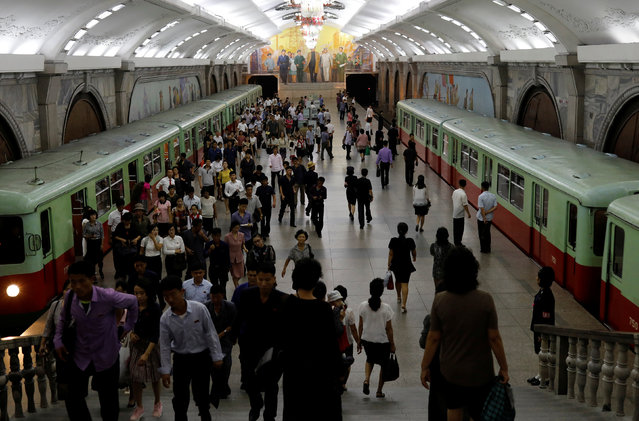 Commuters are seen at a subway station in Pyongyang, North Korea on September 11, 2018. (Photo by Danish Siddiqui/Reuters)