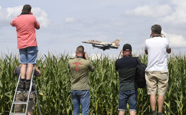 An Israeli F-16 bomber lands at Nörvenich airbase in the Düren district, North Rhine-Westphalia while men with cameras stand by a cornfield and take photographs of the landing on August 17, 2020. Among other things, the jets travel to Germany for joint military exercises with the Bundeswehr. (Photo by Roberto Pfeil/dpa)