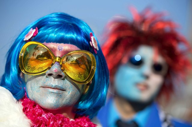 Revelers wearing colorful costumes attend a carnival parade in the center of southeastern town Roermond, The Netherlands, 16 February 2015. (Photo by Marcel Van Hoorn/EPA)