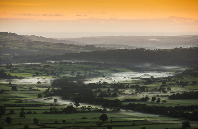 Mist lies in a valley near Goathland in the North Yorkshire Moors at sunrise on September 26, 2013 in Pickering, England. More seasonal Autumnal weather is returning to much of the UK after a late spell of warmer than average temperatures. (Photo by Dan Kitwood/Getty Images)