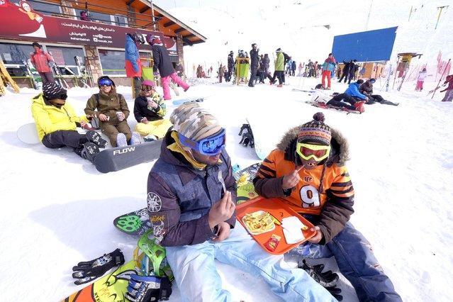 Iranian skiers rest at the Dizin ski resort, northwest of Tehran January 15, 2016. (Photo by Raheb Homavandi/Reuters/TIMA)