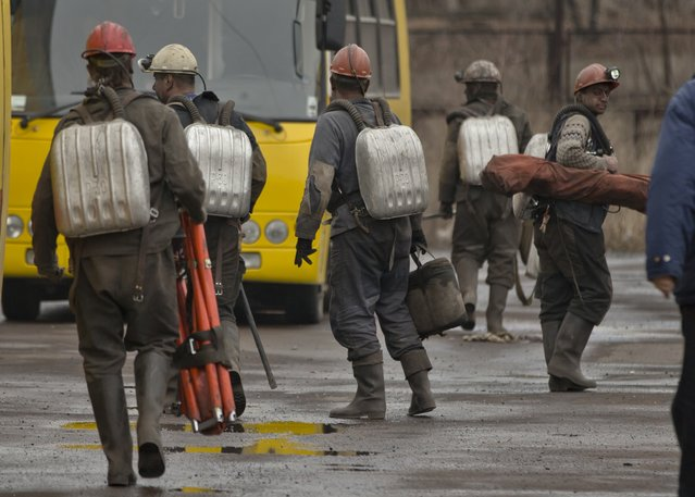 Ukrainian mining rescuers leave after taking part in the search for bodies of miners  killed in an explosion yesterday before dawn at more than 1,000 metres (3,200 feet) underground at the Zasyadko mine, in Donetsk, Ukraine, Thursday, March 5, 2015.Officials in a separatist rebel-held city in east Ukraine say the death toll from an accidental explosion at a coal mine has risen to 32, while one person still remains unaccounted for. (AP Photo/Vadim Ghirda)