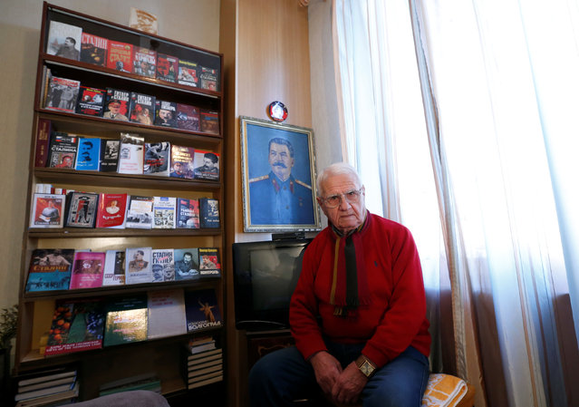 """Retired economist Otar Chigladze, 82, poses for a portrait at his home in Gori, Georgia, December 6, 2016. """"I traveled a lot around the USSR and never missed a chance to buy Stalin memorabilia. I would earn well and could allow myself to do so"""", Chigladze said. (Photo by David Mdzinarishvili/Reuters)"""