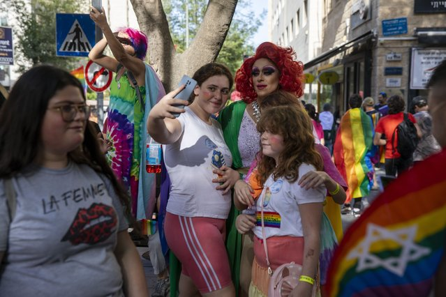 Participants stop for a photo in the annual Gay Pride parade in Jerusalem, Thursday, June 3, 2021. (Photo by Ariel Schalit/AP Photo)