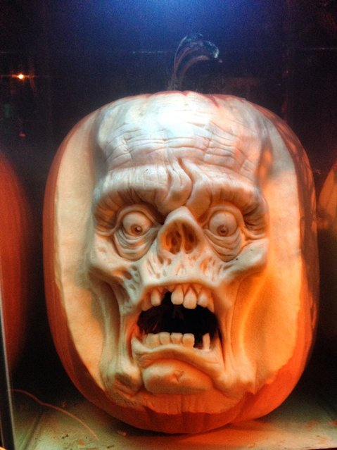A horror face carved out of a pumpkin by Ray Villafane and team in Bellaire, Michigan. (Photo by Ray Villafane/Barcroft Media)