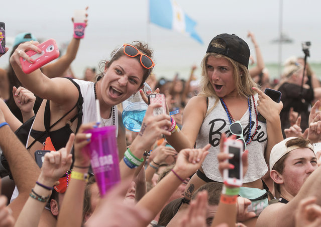 Women take a selfie at a concert by country music super star Luke Bryan during spring break festivities in Panama City Beach, Florida March 12, 2015. (Photo by Michael Spooneybarger/Reuters)