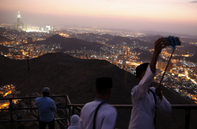 "Muslims take a selfie at the top of Mount Al-Noor during their Umrah Mawlid al-Nabawi ""Birthday of Prophet Mohammad"" in the holy city of Mecca, Saudi Arabia January 16, 2016. (Photo by Amr Abdallah Dalsh/Reuters)"