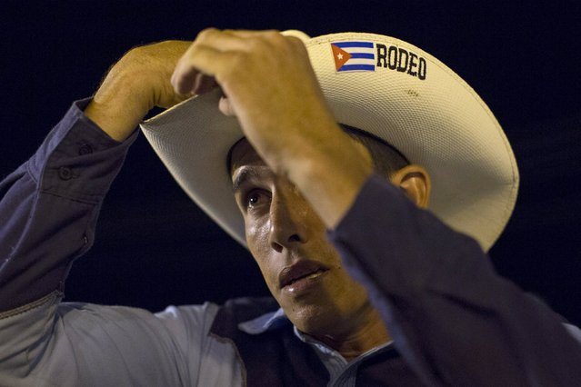 Cowboy Andre Rodriguez, 23, gets ready to perform at the International Livestock Fair Show in Havana March 16, 2015. (Photo by Alexandre Meneghini/Reuters)