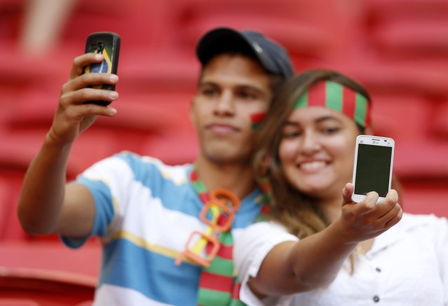 Portugal fans take selfies before the start of the 2014 World Cup Group G soccer match against Ghana at the Brasilia national stadium in Brasilia, in this June 26, 2014 file photo. (Photo by Ueslei Marcelino/Reuters)