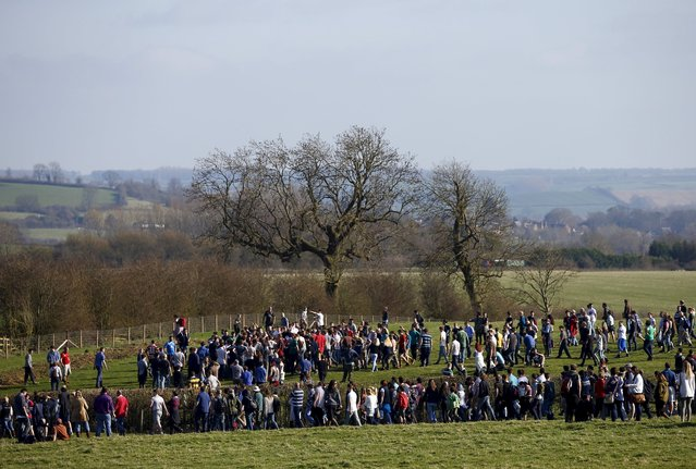 People follow the scrum during the bottle-kicking game in Hallaton, central England April 6, 2015. (Photo by Darren Staples/Reuters)