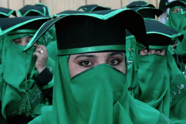 Newly-graduated Afghan midwives attend a commencement ceremony at the Governor's House in Jalalabad, Nangarhar province on December 5, 2013. Some 40 midwives graduated in the ceremony after undergoing a two and half year midwifery programme. (Photo by Noorullah Shirzada/AFP Photo)