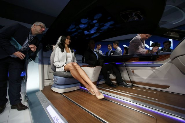 People try out the XIM 17 vehicle interior concept unveiled by Yanfeng Automotive Interiors during the North American International Auto Show in Detroit, Michigan, U.S., January 10, 2017. (Photo by Brendan McDermid/Reuters)