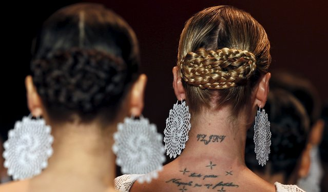 A tatoo is seen in the neck of a model while she presents a creation from the Agua de Coco Summer 2016 Ready To Wear collection during Sao Paulo Fashion Week in Sao Paulo April 14, 2015. (Photo by Paulo Whitaker/Reuters)