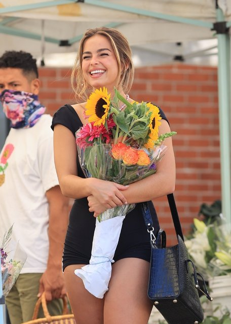 TikTok star Addison Rae looks beaming as she buys flowers at the farmers market wearing tiny black shorts and showing off lots of leg in West Hollywood, CA. on August 29, 2021. (Photo by Backgrid USA)