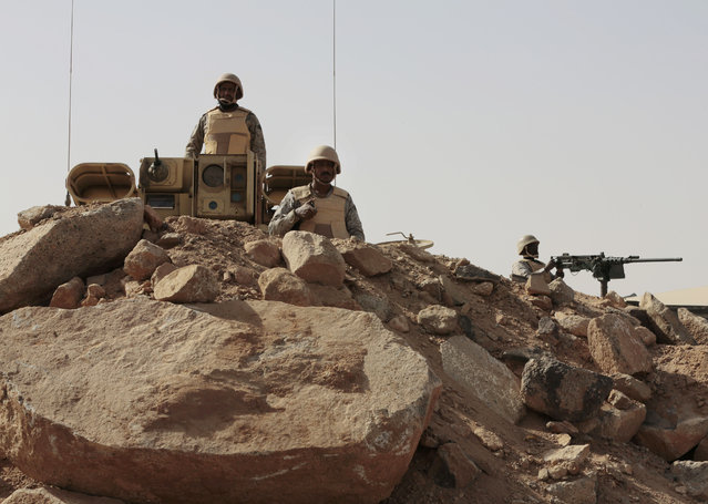 Saudi soldiers stand on top of armor vehicles, on the border with Yemen at a military point in Najran, Saudi Arabia, Tuesday, April 21, 2015. (Photo by Hasan Jamali/AP Photo)