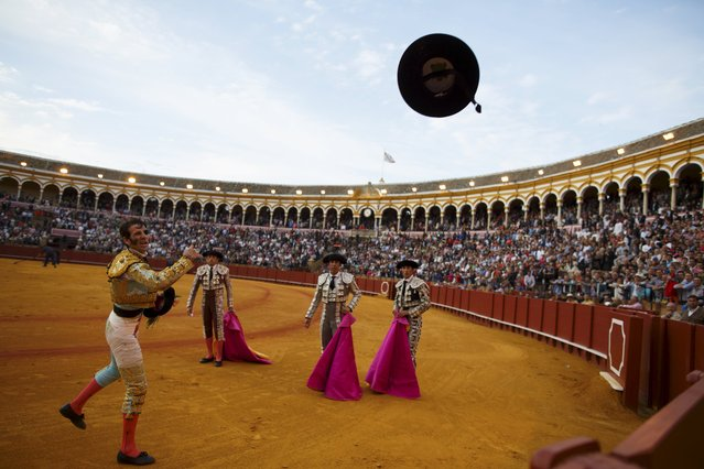 Spanish matador Juan Jose Padilla throws a hat to the crowd as he celebrates his performance during a bullfight at The Maestranza bullring in the Andalusian capital of Seville, southern Spain April 25, 2015. (Photo by Marcelo del Pozo/Reuters)