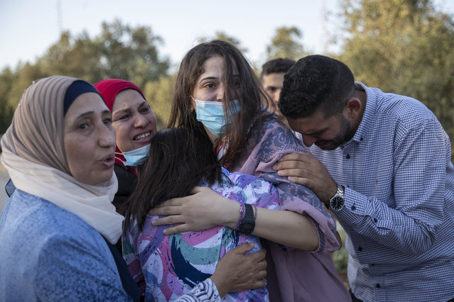 Family members and friends of released Palestinian prisoner Layan Kayed receive her outside the gate of the Israeli Salem checkpoint, in the West Bank city of Jenin, Thursday, September 9, 2021.  Kayed was released from the Israeli Damon prison on Thursday after serving 15 months. (Photo by Nasser Nasser/AP Photo)