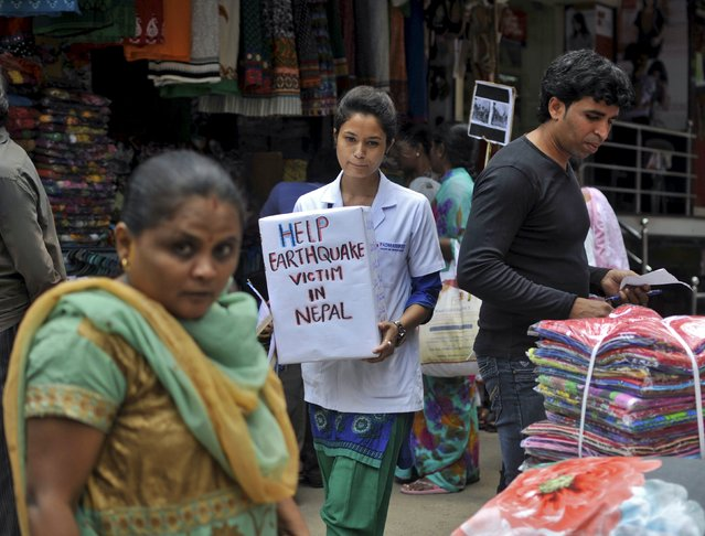 A Nepalese student asks for donation for the survivors of Saturday's earthquake during a vigil at a marketplace in Bengaluru, India, April 28, 2015. (Photo by Abhishek N. Chinnappa/Reuters)